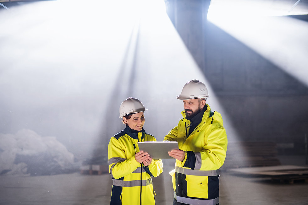 engineers-standing-outdoors-on-construct