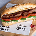 Grilled Sausages with Pomegranate Molasses - سجق مشوي بدبس الرمان