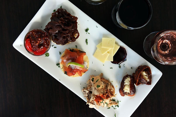 Hors D'Oeuvres plated with wine glasses