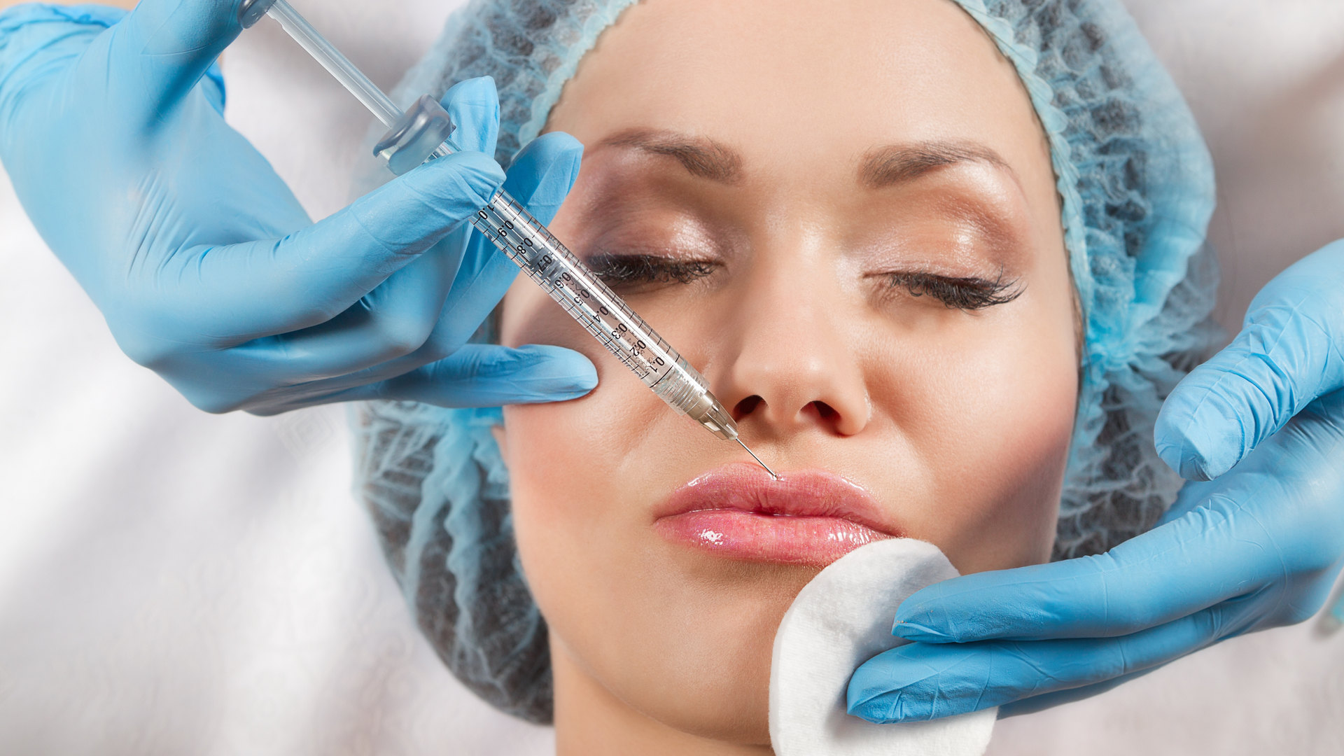 Young woman receiving a botox injection