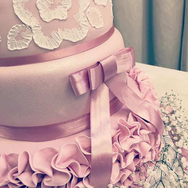 Ruffles and pretty pink bows on our late