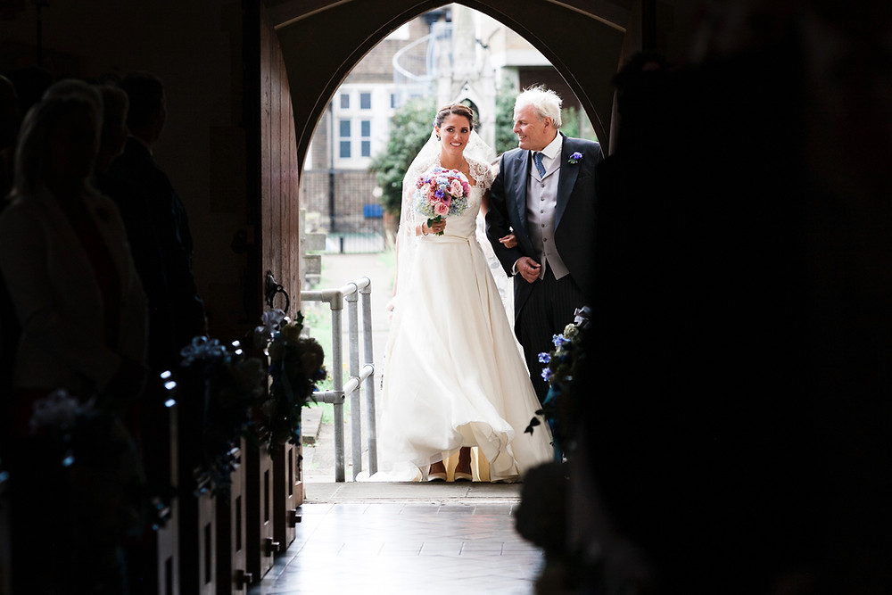 Wedding photo of bride about to enter Church. Time to start thinking about wedding albums.