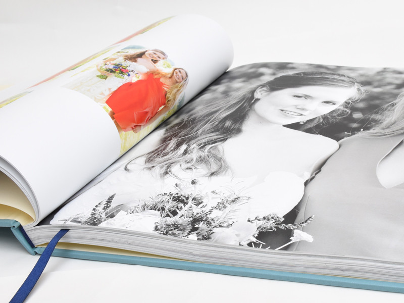 A wedding photobook, many pages bound together like an ordinary book.