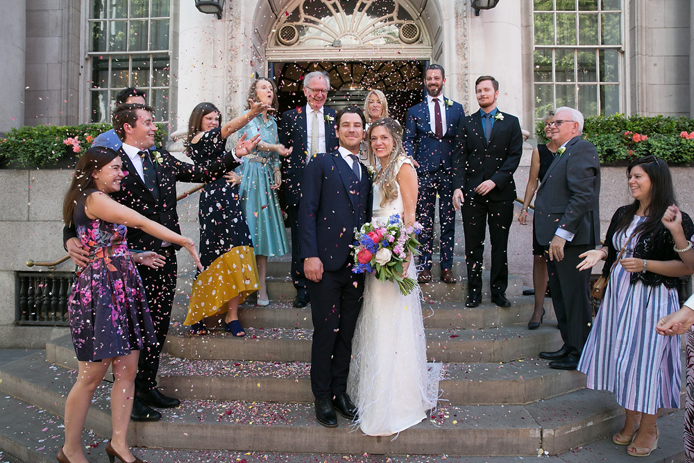 Emma and Ben surrounded by family at Chelsea Registry Office.
