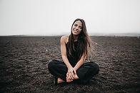 girl sitting on a beach.jpg