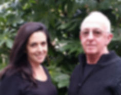"""alt=""""woman and man standing infront of tree Taryn and Paul practitioners at the mind clinic nz"""""""