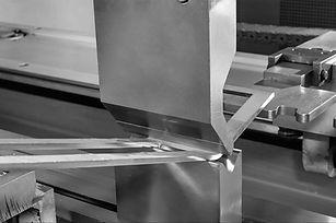 operator bending metal sheet by sheet bending machine.jpg