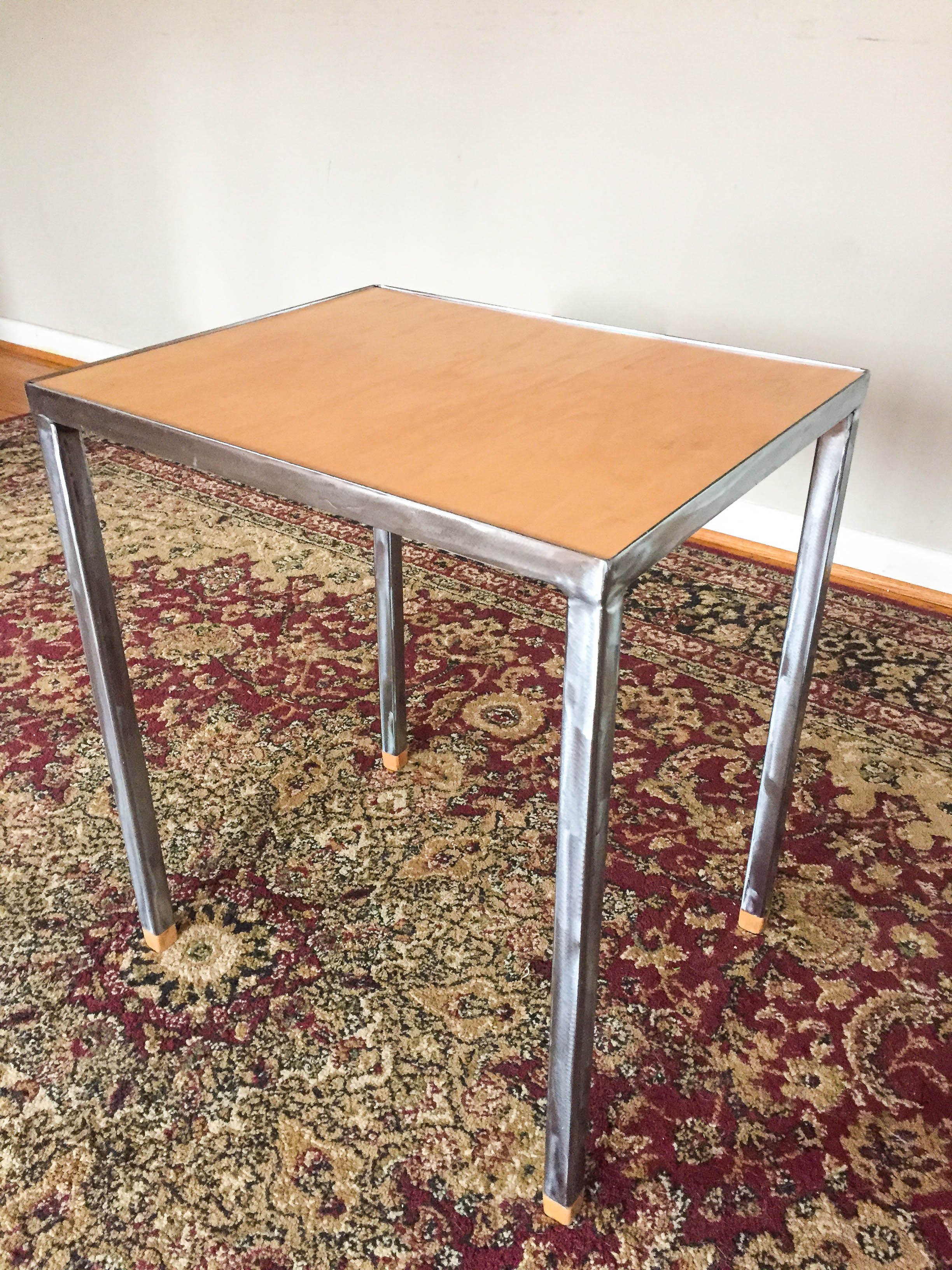 Steel legged end table