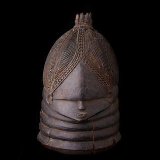 Helmet Mask, from the Bundu/Mende people, Sierra Leone, 20th century.