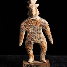 Gift of Dr. John Ross Cat. 2017 JR 76  Colima, Mexico solid ceramic figure, circa 250 BC -AD 250. Dim: 7 x 1 x 3 ¾ inches, figure  only