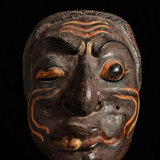 Wood mask representing deformity or sickness