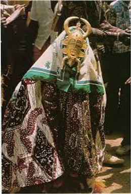 senufo beautiful lady mask performance.j