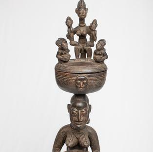 Figure with lidded bowl, Yoruba, Nigeria, wood.
