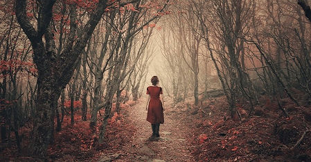 woman in dark woods red dress.jpg