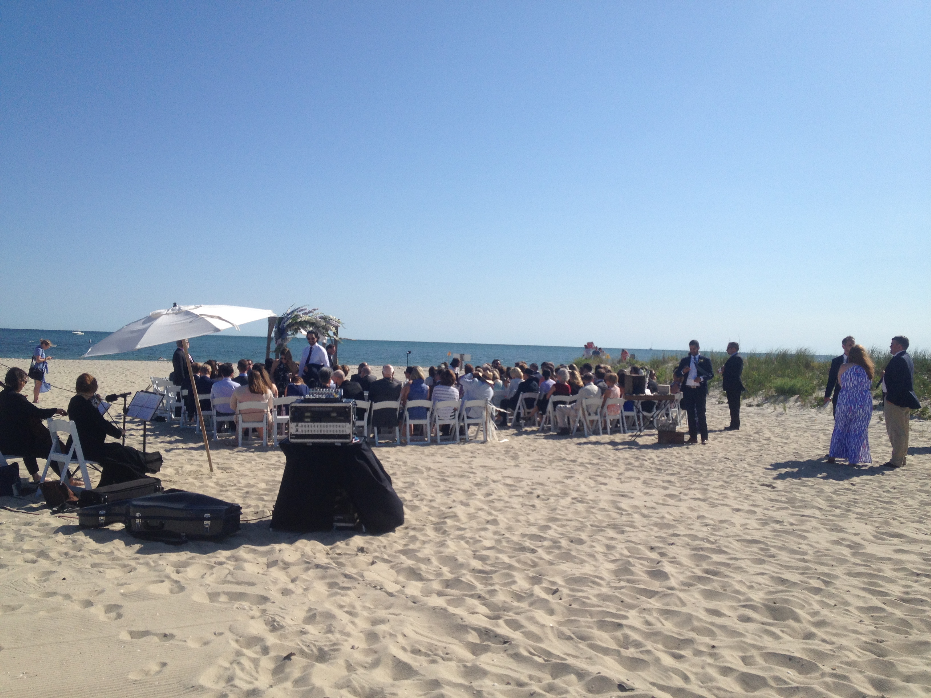 beach wedding set up guests and music