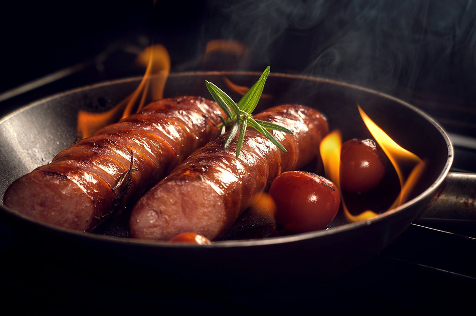 Our signature hotlinks being prepared in a pan.