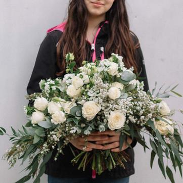 a classic greenery adn white bridal bouquet