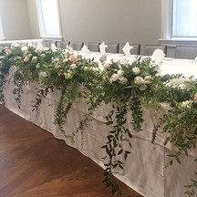 Lush greenery on the head table._._._._.