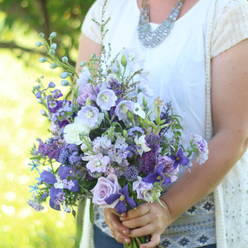A small lavender and purple bridal bouquet
