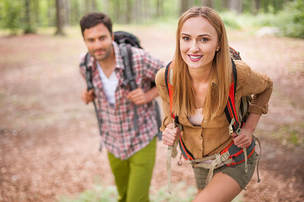 couple-hiking-in-the-forest-F57ZB8L.jpg