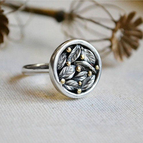 Silver leaf ring with gold berries