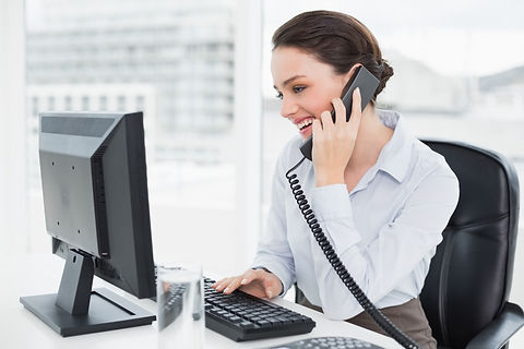 Smiling elegant businesswoman using land
