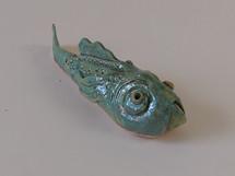 Grumpy green ceramic fish with gold metallic effect glaze by Sarah Burton Pottery