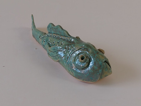 Grumpy green ceramic fish with gold metallic effect glaze by Sarah Burton Pottery