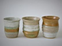 Burnt orange vases by Sarah Burton Pottery