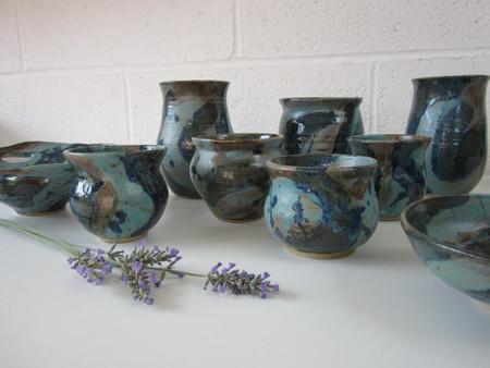 Collection of Turquoise blue ceramic vases and bowls by Sarah Burton Pottery