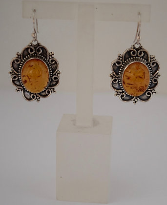 Oval Shape Cognac Baltic Amber with Floral Design Silver Earrings