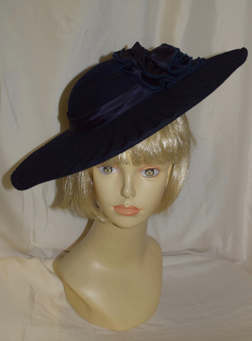 ba405884e622a This vintage Sylvia New York navy blue large brim fancy hat is slightly  used in good condition.