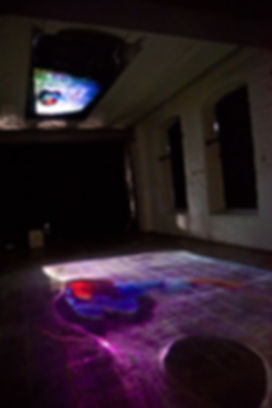 Video projection of a dancer projected on mirror surface and floor