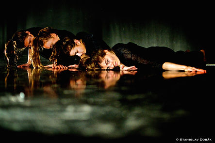 Four female dancers in a structured position