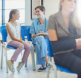Nurse And Patient In Waiting Room