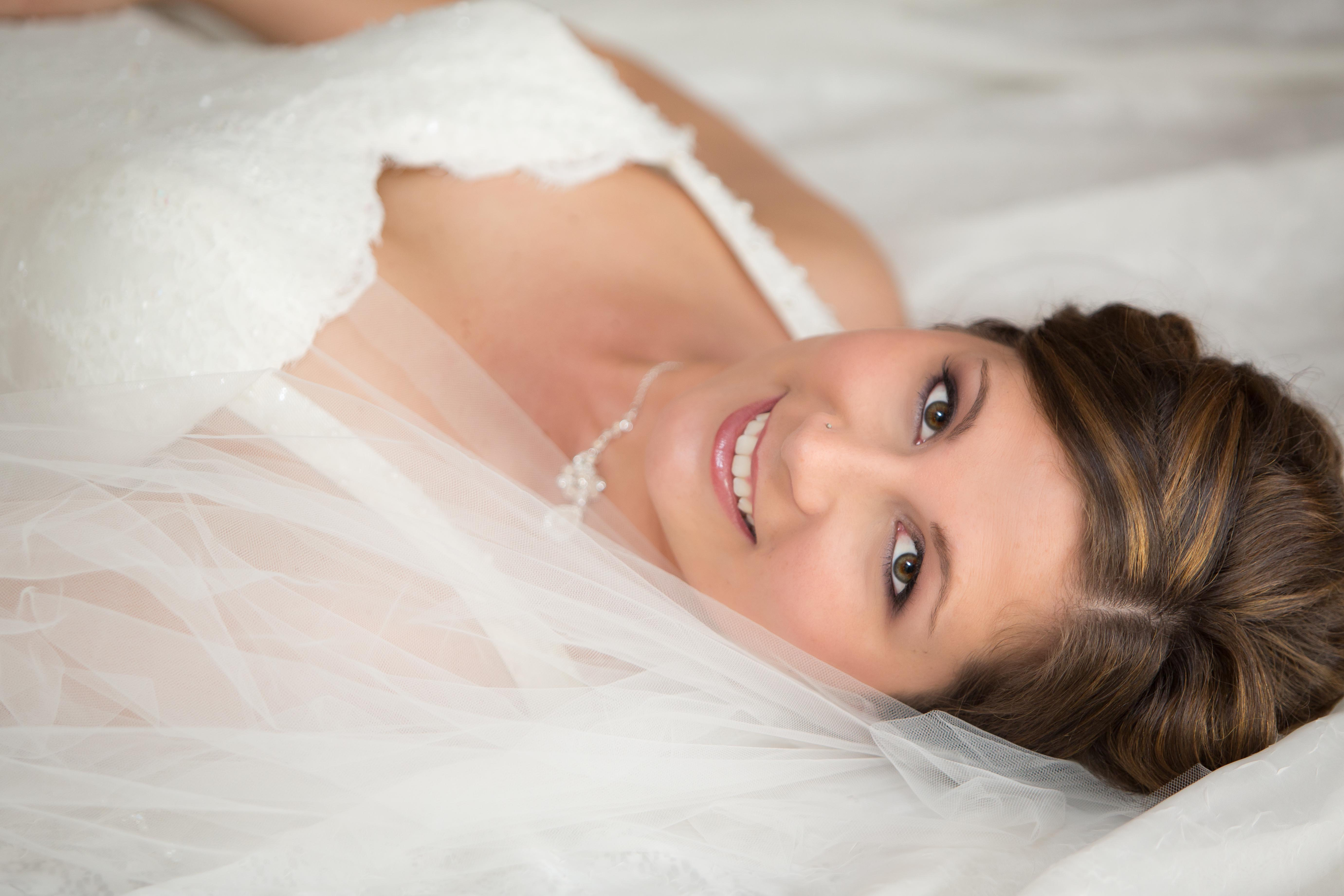 Bride Laying on Bed