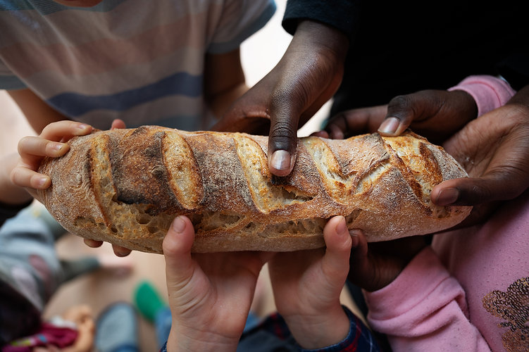 black-and-white-children-holding-loaf-of