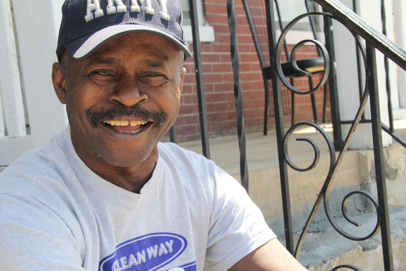 Stan Butler poses on his stoop in York, Pennsylvania in 2016.