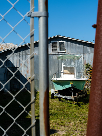 A parked boat waits in a yard in Titusville, Florida.