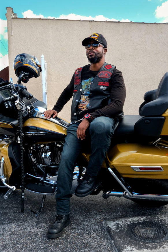 Vick, a motorcyclist, poses in Ybor City in early 2021.