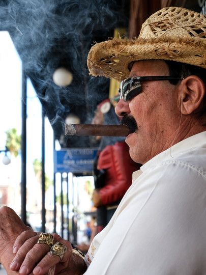 Vick, a Spanish guitarist, enjoys a cigar in Ybor City, Florida, in 2021.