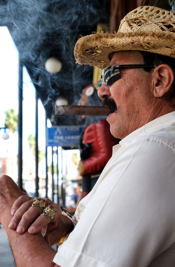Vick, a Spanish guitarist, enjoys a cigar in Ybor City, Florida, in early 2021.