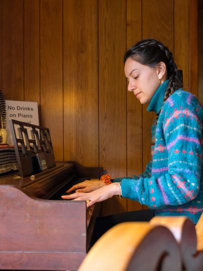 Vanessa plays the pianos in Asheville, North Carolina, in 2021.