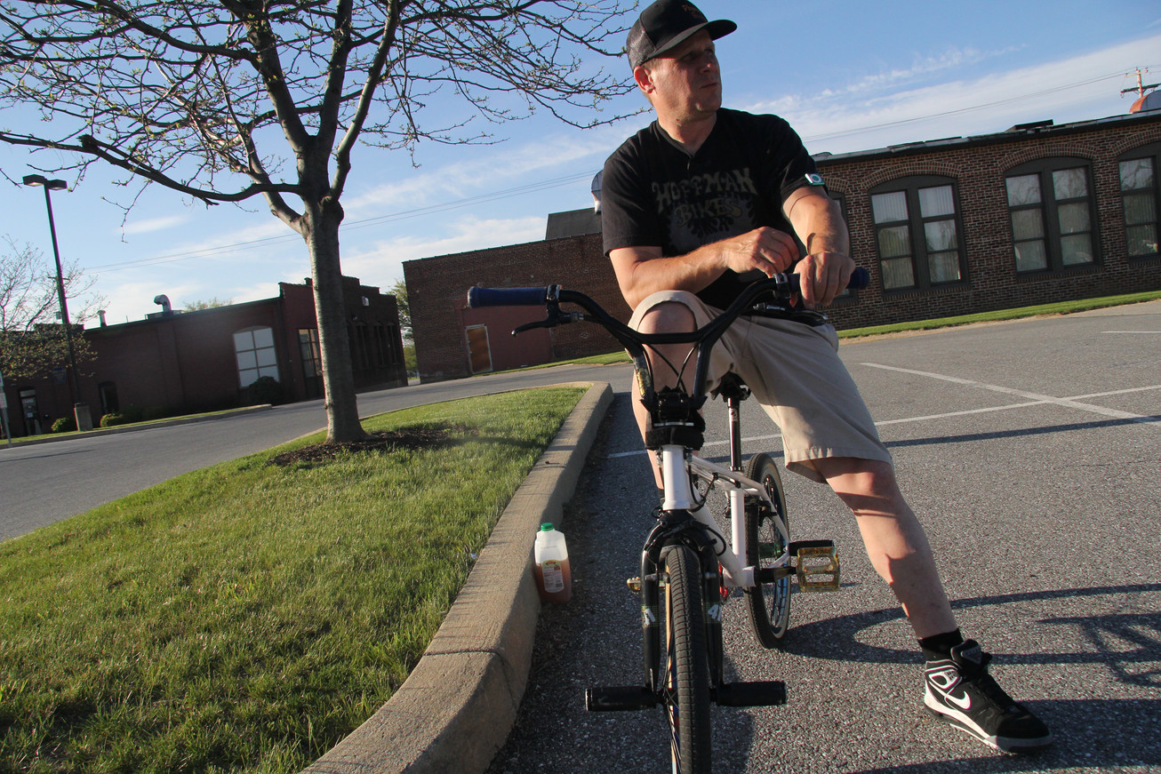 Brett Downs, one of the original members of the Plywood Hoods BMX crew, poses in a parking lot in York, Pennsylvania, in 2016.
