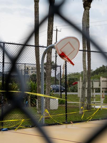 A twisted basketball net outside of New Smyrna Beach, Florida.