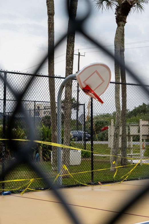 A basketball hoop that's seen better days, in New Smyrna Beach, Florida.