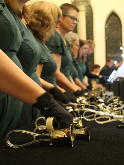 The Hershey Handbell Ensemble prepares for a holiday performance in 2015.