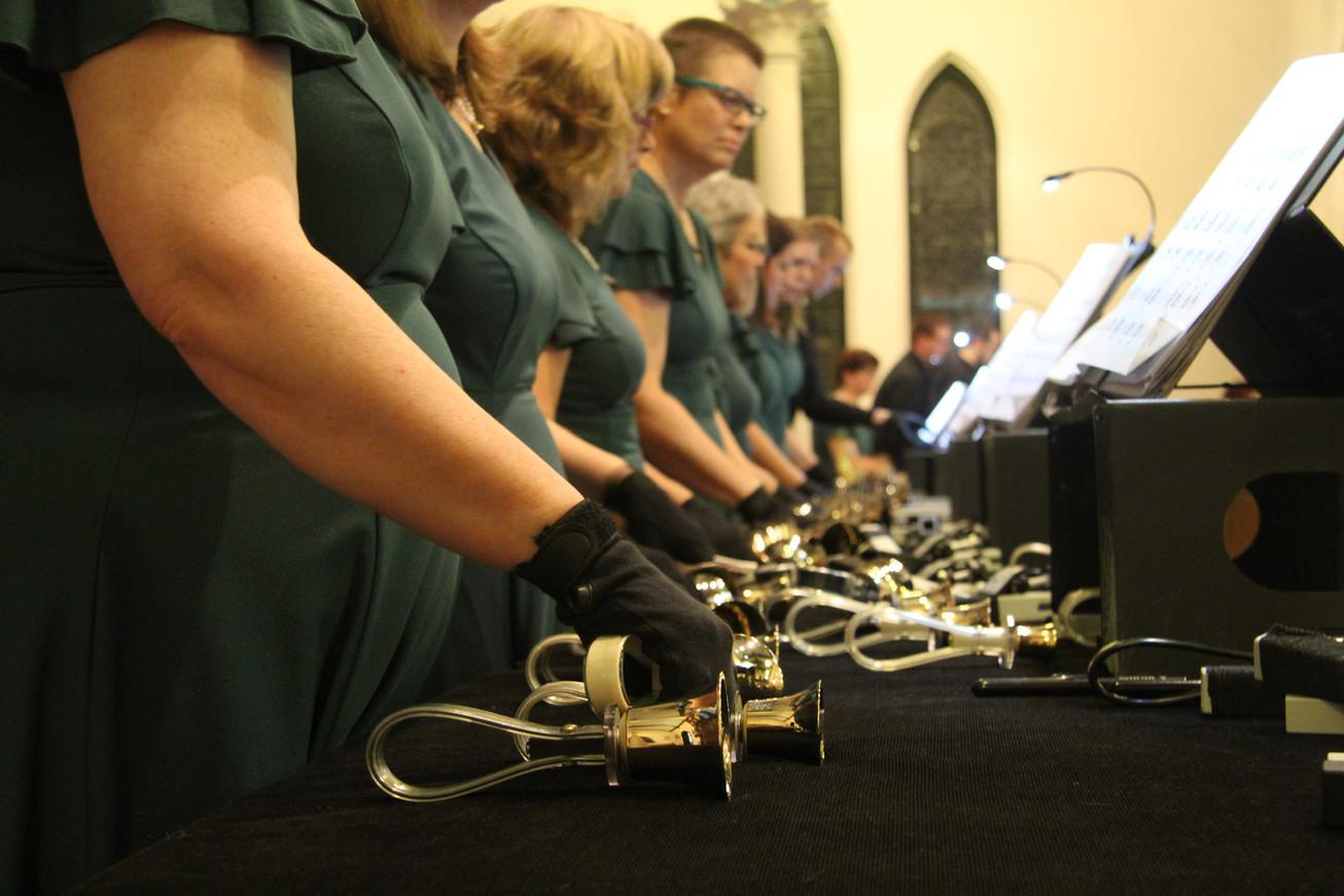 The Hershey Handbell Ensemble prepare for a performance at St. John the Baptist Episcopal Church in York, Pennsylvania, in 2015.