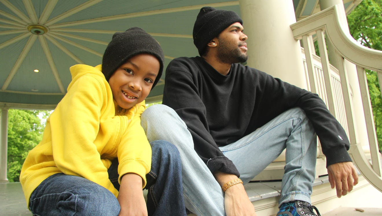 """Jai'on and his uncle D'Andre """"Dre"""" Deshields sit together at Farquhar Park in York, Pennsylvania, in 2016."""