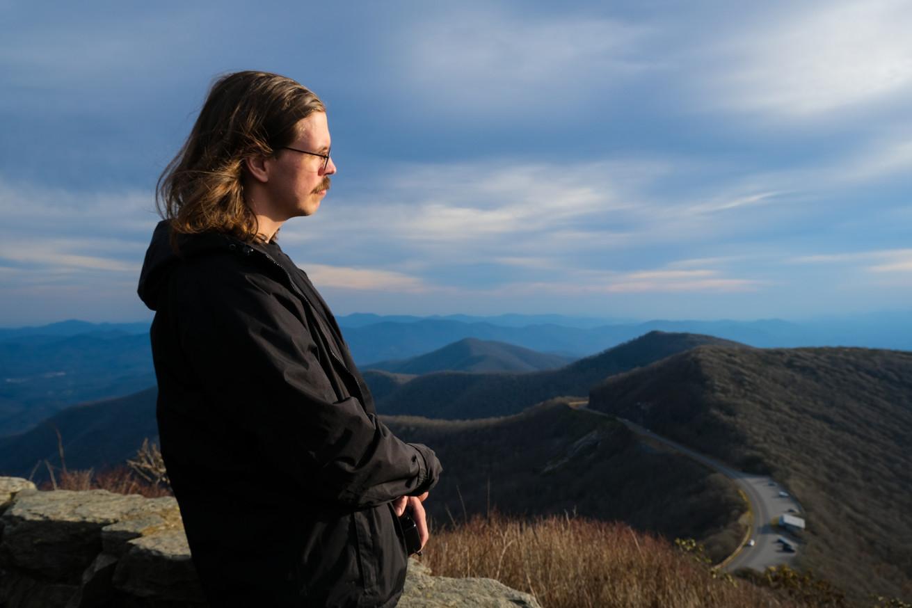 Jordan looks out across the Blue Ridge Mountains in North Carolina.
